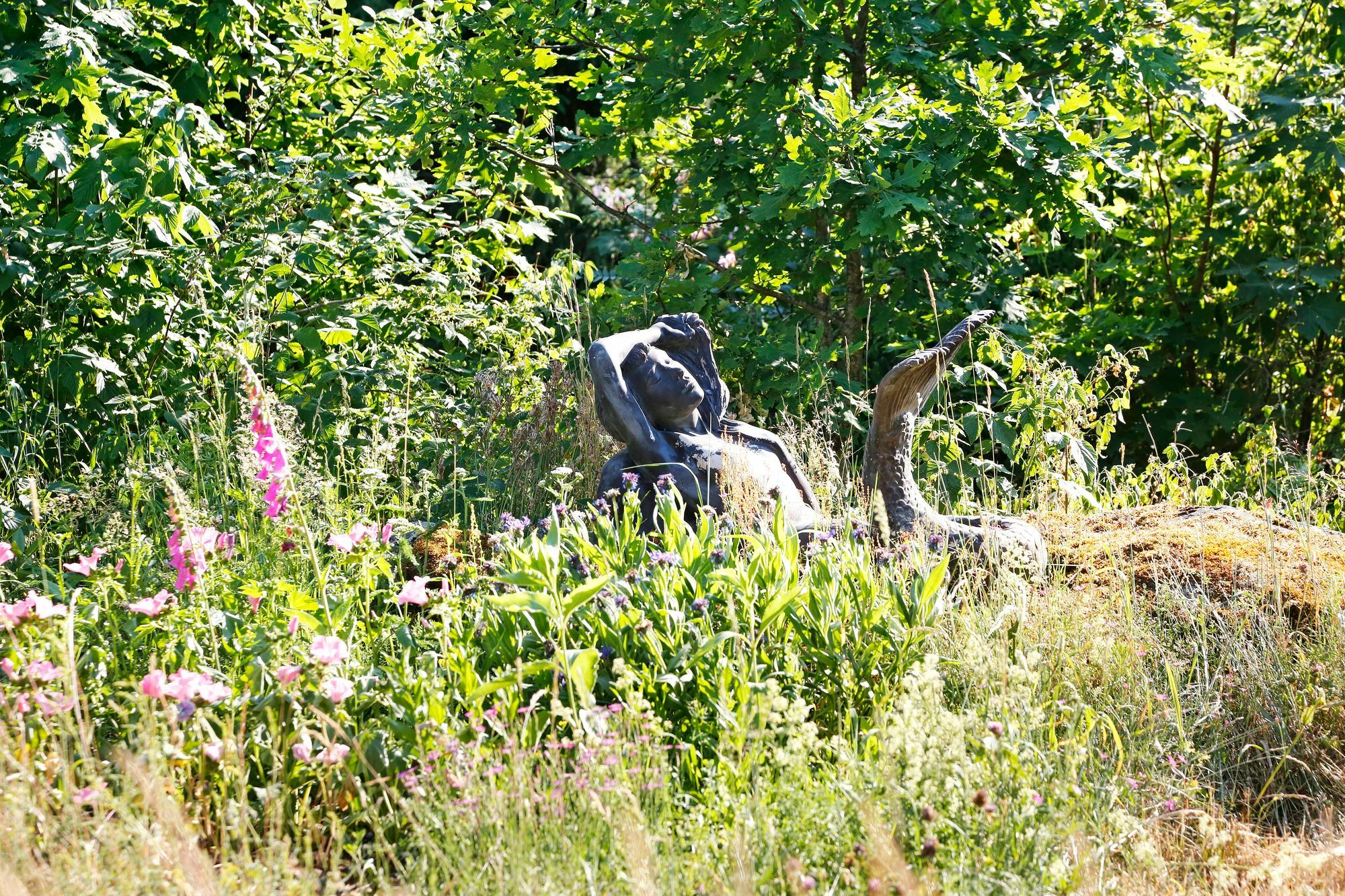 The art also fits into the old milieu, even on the edge of a flower meadow.