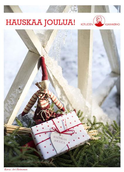 Joulutonttu ja paketti. Toivota Hauskaa joulua Kotilieden e-kortilla