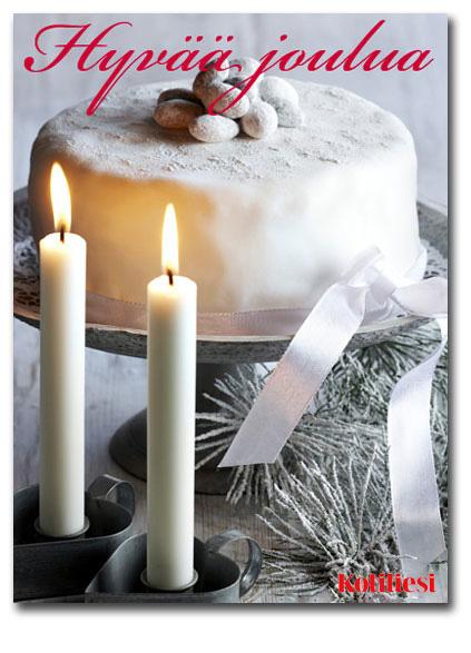 Valkoinen huurrekakku ja kynttilöitä. Toivota Hyvää joulua Kotilieden e-kortilla