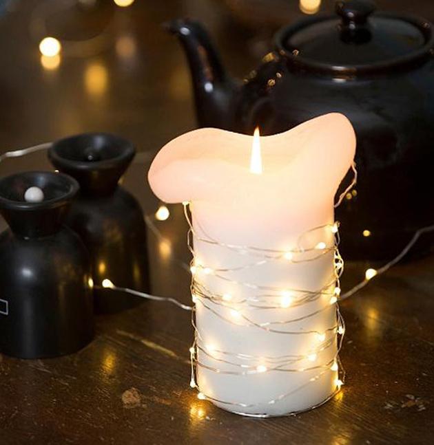 kynttilän ympärille kieritetty jouluvalo