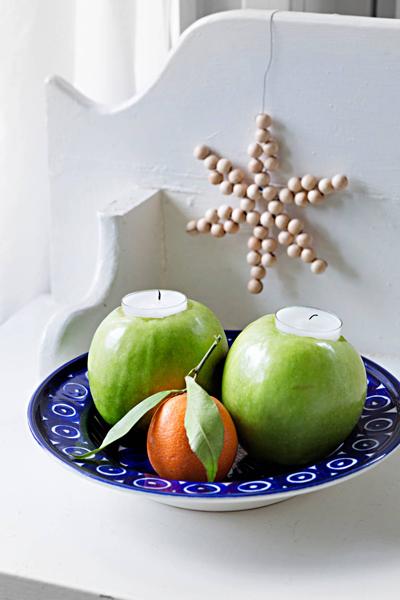 Kynttilät omenoissa
