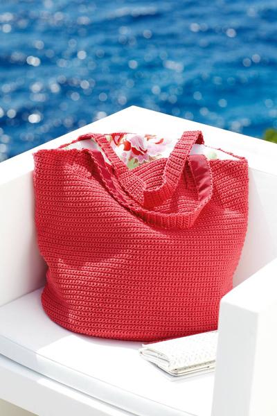 Yksivärinen punainen laukku