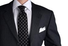 mitä tarkoittaa pukukoodi tumma puku Kauniainen