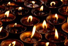 Kuva - Kynttilät haudalla